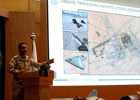 FILE PHOTO: Saudi defence ministry spokesman Colonel Turki Al-Malik displays on a screen drones which Saudi government says attacked an Aramco oil facility, during a news conference in Riyadh