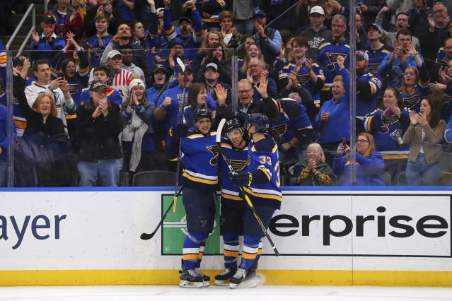 St. Louis Blues winger Jaden Schwartz (17) celebrates his goal against the Winnipeg Jets with Blues' Brayden Schenn (10) and St. Louis Blues center Jordan Kyrou (33) during the second period of an NHL hockey game Sunday, Dec. 29, 2019, in St. Louis. (AP Photo/Dilip Vishwanat)
