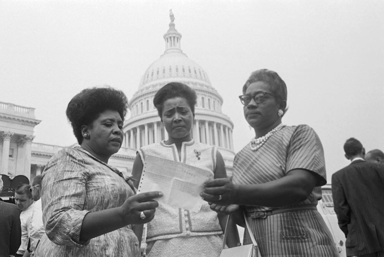 The House of Representatives met today to affirm seating of its Mississippi members, as Civil Rights demonstrators massed in silent support of their claim that the State's elections were illegal because blacks were barred from the polls August 17, 1965. Three members of the Mississippi Freedom Democratic Party's contestants for the state's five seats hold a telegram from Speaker John McCormick granting them permission to take seats on the House floor during the debate. They are, left to right: Fannie Lou Hamer, Victoria Gray, and Annie Devine.
