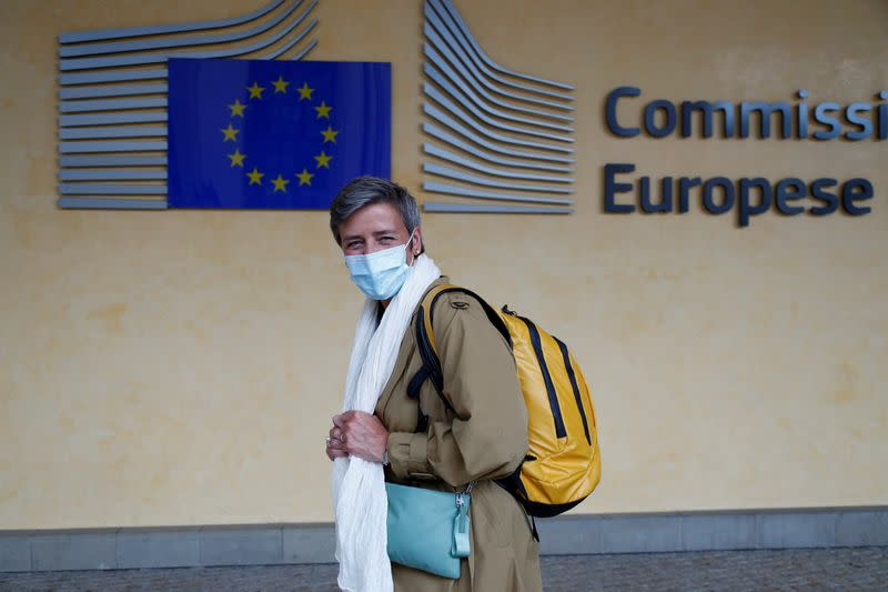 FILE PHOTO: European Competition Commissioner Margrethe Vestager wearing a protective mask leaves the EU Commission headquarters in Brussels