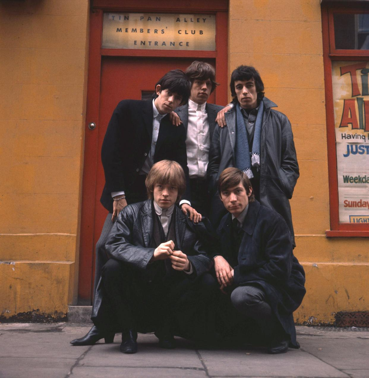 The Rolling Stones pose outside the Tin Pan Alley Club in London, early 1964. Clockwise from top left, Keith Richards, Mick Jagger, Bill Wyman, Charlie Watts and Brian Jones (1942 - 1969). (Photo by Terry O'Neill/Hulton Archive/Getty Images)