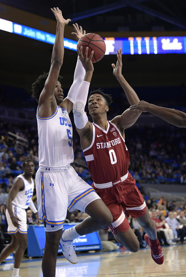 FILE - In this Jan. 3, 2019, file photo, Stanford forward KZ Okpala, right, shoots as UCLA guard Chris Smith defends during the first half of an NCAA college basketball game, in Los Angeles. Okpala is one of the top forwards in Thursday's NBA draft. (AP Photo/Mark J. Terrill, File)