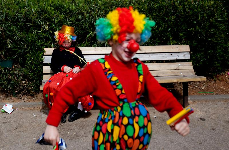 Two Ultra Orthodox Jewish boys dress as clowns during the Purim festival in the ultra-Orthodox town of Bnei Brak, Israel, Sunday, Feb. 24, 2013. (AP Photo/Ariel Schalit)