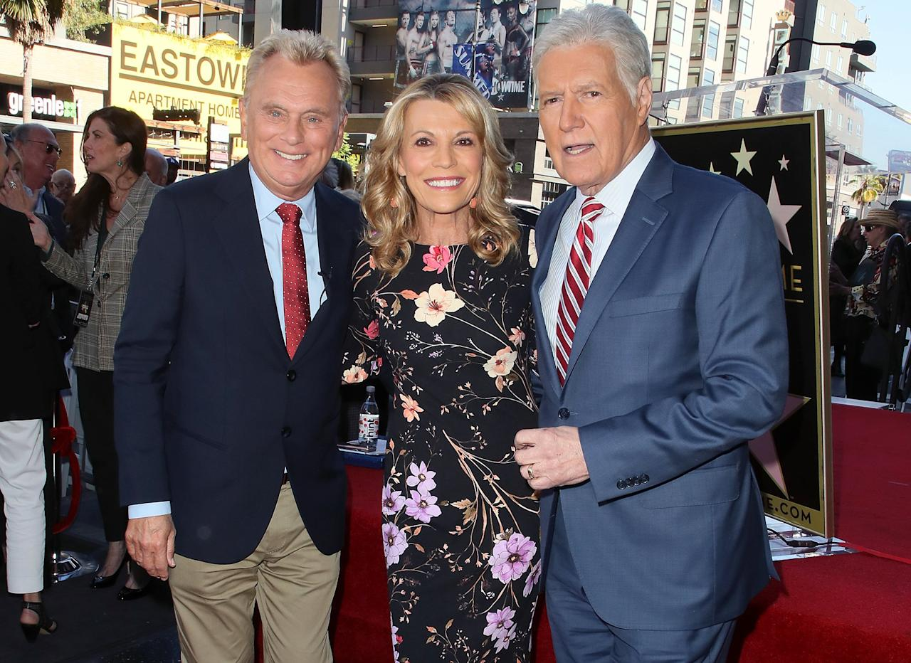 <em>Wheel of Fortune</em>'s Pat Sajak and Vanna White pose alongside <em>Jeopardy</em>'s Alex Trebek at the ceremony honoring the game shows' executive producer Harry Friedman with a Star on the Hollywood Walk of Fame on Friday in Hollywood.