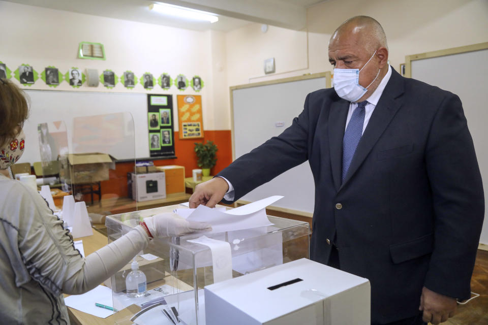 In this photo released by the GERZB Party, Bulgarian Prime Minister Boyko Borissov casts his ballot during parliamentary elections in the town of during the parliamentary elections in the town of Bankya, Bulgaria, Sunday, April 4, 2021. Bulgarians are heading to the polls on Sunday to cast ballots for a new parliament after months of anti-government protests and amid a surge of coronavirus infections. (GERB Party via AP)