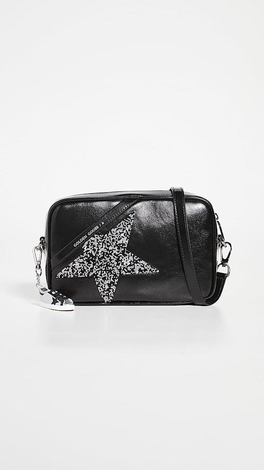 "<p>This <product href=""https://www.shopbop.com/star-bag-golden-goose/vp/v=1/1599249723.htm?folderID=13505&amp;fm=other-viewall&amp;os=false&amp;colorId=15892&amp;ref_=SB_PLP_NB_69"" target=""_blank"" class=""ga-track"" data-ga-category=""Related"" data-ga-label=""https://www.shopbop.com/star-bag-golden-goose/vp/v=1/1599249723.htm?folderID=13505&amp;fm=other-viewall&amp;os=false&amp;colorId=15892&amp;ref_=SB_PLP_NB_69"" data-ga-action=""In-Line Links"">Golden Goose Star Bag</product> ($585) is what we call classic with a twist, and we're very into it.</p>"