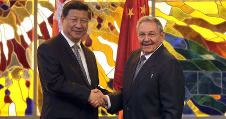 Cuba's President Castro shakes hands with China's President Xi during a meeting in Havana's Revolution Palace