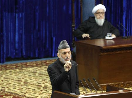 Afghan President Hamid Karzai speaks during the opening of the Loya Jirga, or grand council, in Kabul November 21, 2013. REUTERS/Omar Sobhani