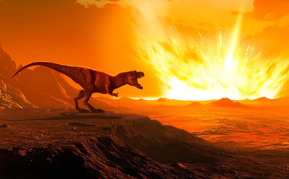 Illustration of a Tyrannosaurus as an asteroid strikes the earth. (Photo: MARK GARLICK/SCIENCE PHOTO LIBRARY via Getty Images)