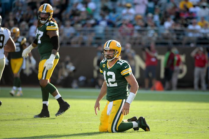 Green Bay Packers quarterback Aaron Rodgers (12) gets up after a play during the second half of an NFL football game against the New Orleans Saints, Sunday, Sept. 12, 2021, in Jacksonville, Fla.