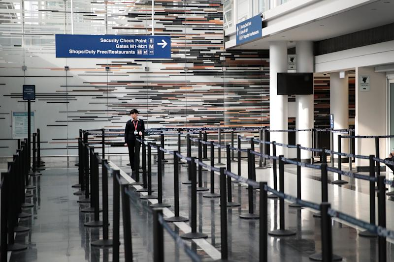 A worker staffs a security checkpoint