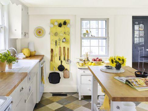 <p>In this small kitchen with limited wall space, the area underfoot offers ample opportunity to add interest, as shown here with linoleum tiles. Butcher block countertops (practical and pretty) warm up the white room without feeling too heavy. Pegboard painted a schoolbus yellow keeps assorted tools at the ready. <br></p>