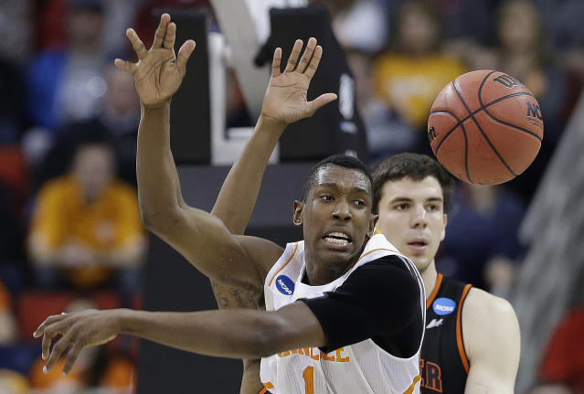 Tennessee guard Josh Richardson (1) passes the ball against Mercer forward Daniel Coursey (52) during the first half of an NCAA college basketball third-round tournament game, Sunday, March 23, 2014, in Raleigh. (AP Photo/Gerry Broome)