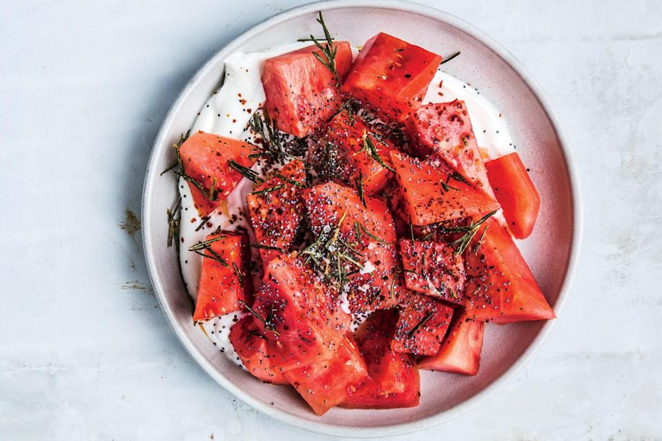 "There's no reason for a refreshing watermelon salad to ever be boring. This combination is at once sweet, tart, and savory—it works whatever time of day you serve it. <a href=""https://www.epicurious.com/recipes/food/views/watermelon-with-yogurt-poppy-seeds-and-fried-rosemary?mbid=synd_yahoo_rss"" rel=""nofollow noopener"" target=""_blank"" data-ylk=""slk:See recipe."" class=""link rapid-noclick-resp"">See recipe.</a>"