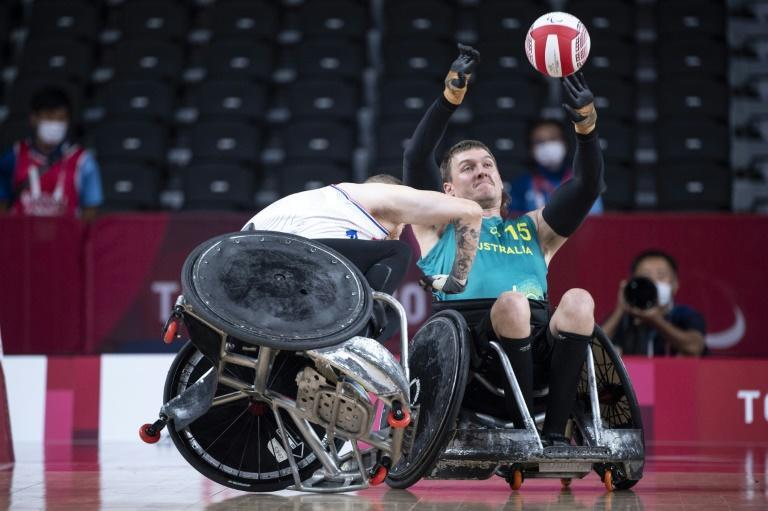 The battering rams of wheelchair rugby have no compunction about bashing into players to stop a try (AFP/Charly TRIBALLEAU)