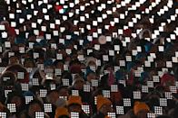 <p>People attend the opening ceremony of the Pyeongchang 2018 Winter Olympic Games at the Pyeongchang Stadium on February 9, 2018. / AFP PHOTO / Mark RALSTON </p>