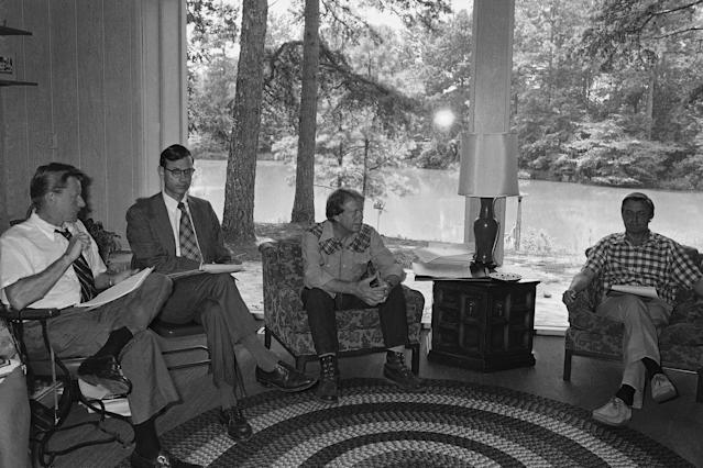 <p>Democratic nominee Jimmy Carter, center, talks with Zbigniew Brzezinski of Columbia University and Carters foreign policy advisor, left, and Stuart Eizenstat, director of issues and policies, second from left, Thursday, July 29, 1976, Plains, Ga. Carter is being briefed on foreign policy in the Carter pond house which is used as country home. The man on the right is unidentified. (Photo: Peter Bregg/AP) </p>