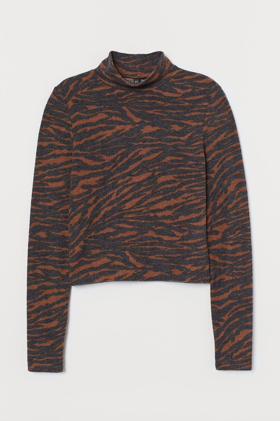 <p>This <span>H&amp;M Fine-knit Sweater</span> ($11, originally $18) will look great with black leather jeans.</p>