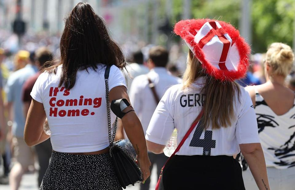 Fans wearing shirts saying 'It's coming home' and 'Gerrard 4'.