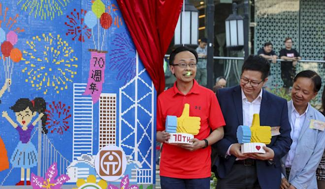 Patrick Nip, left, was attending an event to celebrate the 70th anniversary of the People's Republic of China, in Tsing Yi. Photo: Felix Wong