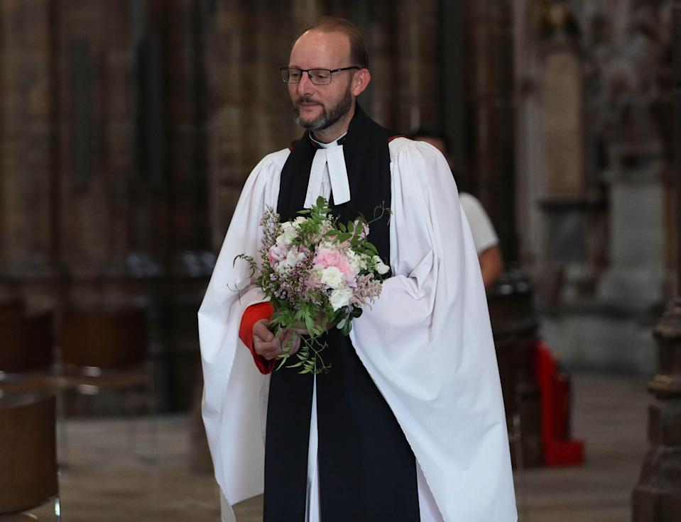 Reverend Anthony Ball, Canon of Westminster in Westminster Abbey in London with Princess Beatrice's wedding bouquet which, like those of Royal brides, is traditionally placed on the Tomb of the Unknown Warrior. (PA Images)