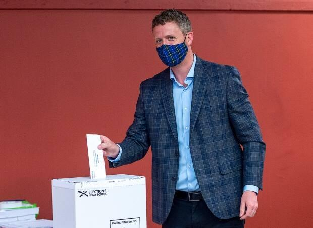 Liberal Leader Iain Rankin casts his ballot in the provincial election in Halifax on Friday, July 30, 2021. (Andrew Vaughan/Canadian Press - image credit)