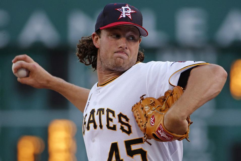 Pittsburgh Pirates starting pitcher Gerrit Cole warms up before the fifth inning of a baseball game against the Philadelphia Phillies in Pittsburgh, Friday, July 4, 2014. (AP Photo/Gene J. Puskar)