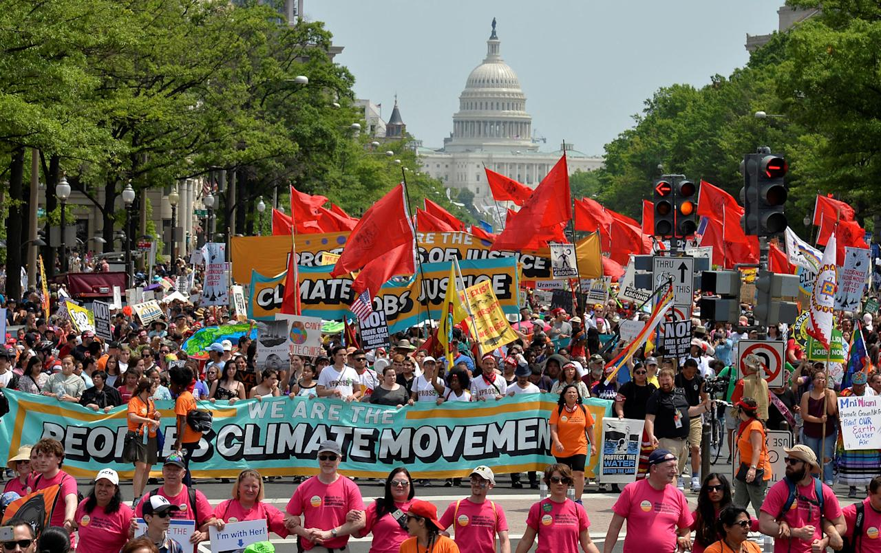 <p>Demonstrators march down Pennsylvania Avenue during a People's Climate March, to protest U.S. President Donald Trump's stance on the environment, in Washington, U.S., April 29, 2017. (Mike Theiler/Reuters) </p>