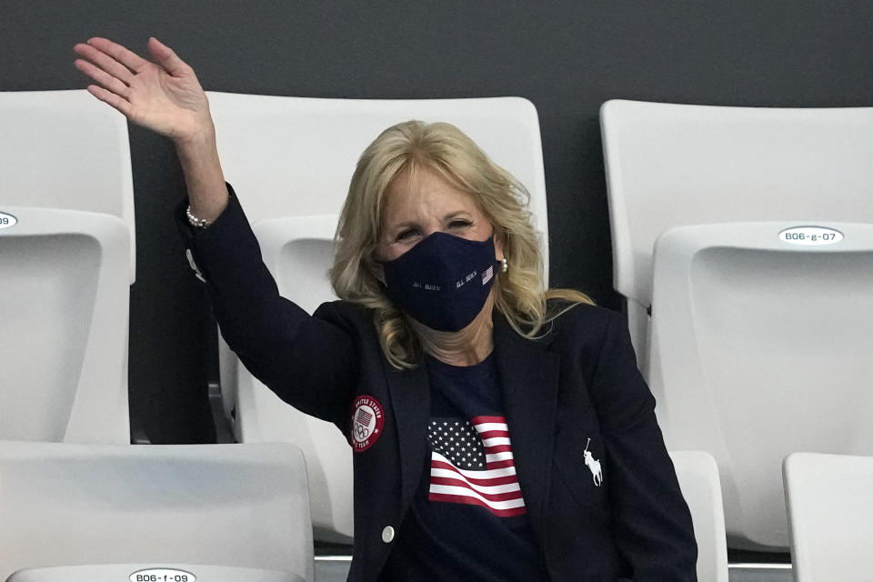 First lady of the United States, Jill Biden waves during a swimming event at the 2020 Summer Olympics, Saturday, July 24, 2021, in Tokyo. (AP Photo/Petr David Josek)