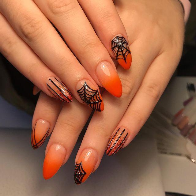 """<p>These high-gloss, dip dyed, orange nails are finished off with webbing detail and we're very into it.</p><p><a href=""""https://www.instagram.com/p/B3ePTEgheDf/"""" rel=""""nofollow noopener"""" target=""""_blank"""" data-ylk=""""slk:See the original post on Instagram"""" class=""""link rapid-noclick-resp"""">See the original post on Instagram</a></p>"""