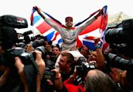 Champion of the world: Hamilton celebrates winning his sixth world title in Texas last year