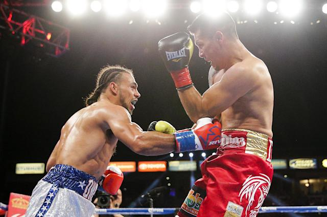 Keith Thurman, left, lands a body punch on Julio Diaz during the third round of a WBA interim welterweight title boxing match on Saturday, April 26, 2014, in Carson, Calif. Thurman won by TKO after the third round after Diaz wasn't able to come out for the fourth round due to his rib injury. (AP Photo/Jae C. Hong)