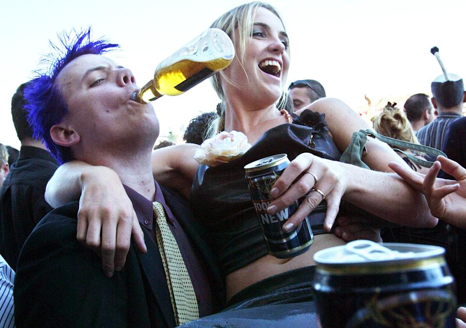A couple, pictured here drinking beer after the Melbourne Cup in 2003.