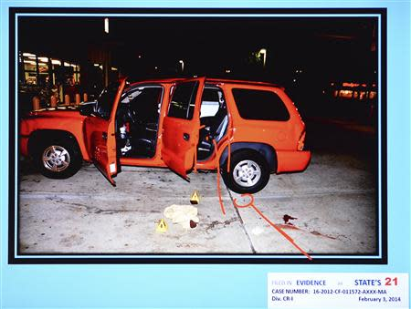 A state evidence photo presented February 7, 2014 during the murder trial of Michael Dunn in Jacksonville, Florida, shows the red Durango SUV where Jordan Davis was seated when he was shot at a gas station during an altercation. REUTERS/Bob Mack/The Florida Times-Union/Pool
