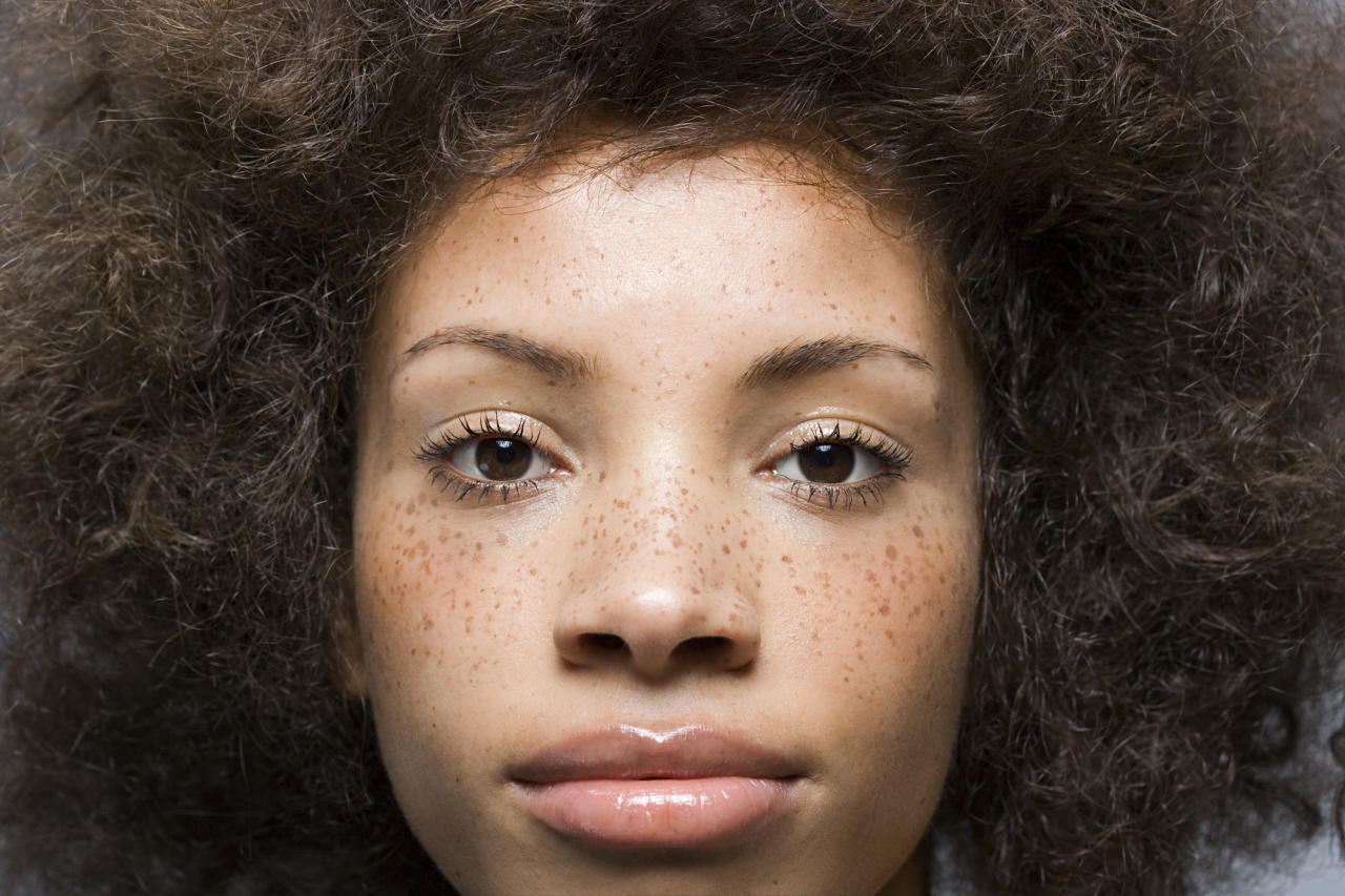 Go bare and share your freckles with the world. A single coat of mascara is sometimes all the makeup you need.  <i>Photo:Image Source/Getty Images</i>