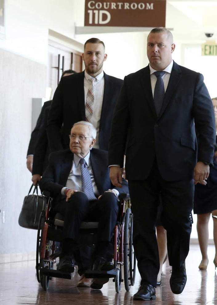 Former U.S. Senator Harry Reid, who sued the makers of an exercise band after injuring his eye, leaves the courtroom after attending the first day of jury selection in his civil trial at the Regional Justice Center on Monday, March. 25, 2019, in Las Vegas. (Bizuayehu Tesfaye/Las Vegas Review-Journal via AP)