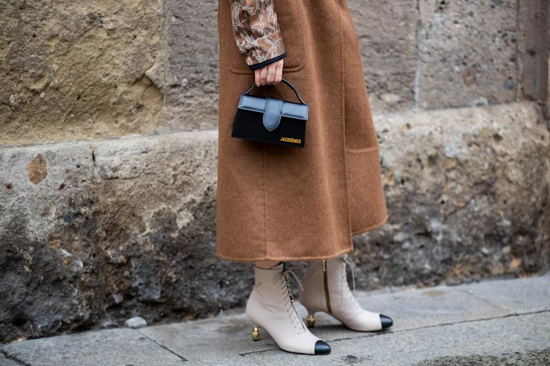 MILAN, ITALY - SEPTEMBER 24: A guest is seen wearing Jacquemus bag, brown outside Max Mara during the Milan Women's Fashion Week on September 24, 2020 in Milan, Italy. (Photo by Christian Vierig/Getty Images)