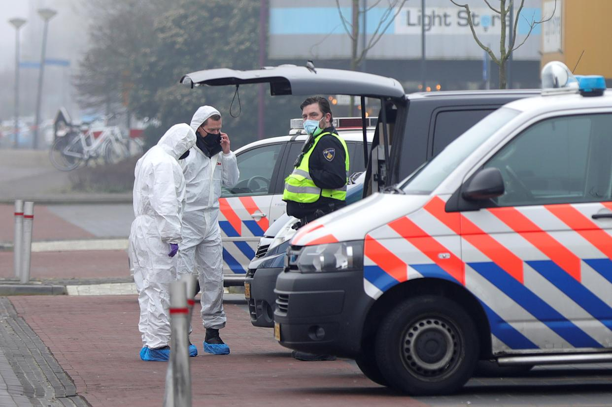Forensic officers investigate the area at the scene of an explosion at a coronavirus disease (COVID-19) testing location in Bovenkarspel, near Amsterdam, Netherlands March 3, 2021. REUTERS/Eva Plevier