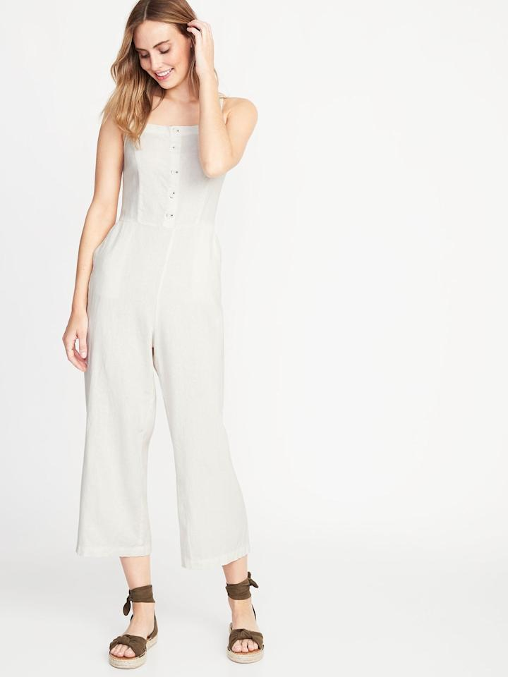 """<p>Trade in you LBD for this <a href=""""https://www.popsugar.com/buy/Button-Front-Linen-Blend-Cami-Jumpsuit-476165?p_name=Button-Front%20Linen-Blend%20Cami%20Jumpsuit&retailer=oldnavy.gap.com&pid=476165&price=45&evar1=fab%3Aus&evar9=46461305&evar98=https%3A%2F%2Fwww.popsugar.com%2Fphoto-gallery%2F46461305%2Fimage%2F46461316%2FButton-Front-Linen-Blend-Cami-Jumpsuit&list1=shopping%2Cold%20navy%2Csummer%2Csummer%20fashion&prop13=api&pdata=1"""" rel=""""nofollow"""" data-shoppable-link=""""1"""" target=""""_blank"""" class=""""ga-track"""" data-ga-category=""""Related"""" data-ga-label=""""https://oldnavy.gap.com/browse/product.do?pid=412889002&amp;cid=1106616&amp;pcid=1038317&amp;grid=pds_99_168_1#pdp-page-content"""" data-ga-action=""""In-Line Links"""">Button-Front Linen-Blend Cami Jumpsuit</a> ($45). We love that it can be dressed up or down. Headed to a dinner party? Throw on a pair of heels and a cute purse. Going to the beach with friends? Take it as a cover-up. Best of all, the breathable linen fabric will keep you sweat-free. </p>"""