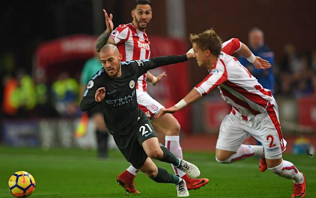 "9:55PM Full time Manchester City restore their lead to 16 points with a masterly, indeed masterful, victory over 19th-placed Stoke who are not unique in being comprehensively outclassed. David Silva was brilliant, Raheem Sterling also played very well. 9:53PM 90+5 min Keepball from City for 90 seconds until Bauer picks off a pass from David Silva. They work it up the right and Bauer spears in a deep cross that bypasses Crouch. The ref has seen enough and emits three peeps from his Acme Thunderer. 9:51PM 90+4 min City corner on the right. The Silvas twain and De Bruyne knock it about and go all the way back to Ederson who starts a foray up the left with Zinchenko who then move sit back to safety in midfield. 9:49PM 90+2 min We'll have five minutes added because of Otamendi's cut. Stafylidis lets fly from 30 yards and cracks his shot into Otamendi. 9:48PM 90 min City sub: Ilkay Gundogan on, Gabriel Jesus off. David Silva is named man of the match. 9:47PM 88 min Stoke sub: Ramadan Sobhi on for Geoff Cameron. Seems a little pointless and cruel. You've had naff all football under Lambert then he chucks you on for 90 seconds of a game you've long lost? Must be tempting to tell him to get stuffed. 9:44PM 86 min Stoke corner on the right, curled by Shaqiri straight down Ederson's throat. He sparks a rapid City break from which they're caught offside, back come Stoke and Komany makes the only telling tackle that has been required of him all night. 9:42PM 84 min City sub: Sterling, who has played very well, departs to a chorus of disapproval. Bernardo Silva takes his place. 9:41PM 82 min Don't know how Sterling missed that, or what Jon Moss said to City at the drop ball. But even City's fans went a but quiet after it. 9:39PM 79 min Jonathan Moss restarts the game with a drop ball 40 yards out. City contest it, Stoke don't because they think they were going to have possession. Sterling hares off towards goal with Ndiaye chasing him looking intent on whacking him with more than an etiquette guide. Sterling, with Jesus in support, drops his shoulder and veers to the right to try to round Butland which gives Ndiaye the opening to whip the ball behind for a corner. All hell then breaks loose about City's alleged chicanery. 9:35PM 78 min Otamendi is back on his feet having wrapped his head in Elastoplast. 9:35PM 76 min Sane stings Butland's palms with a flayed shot then there's quite a stoppage when Otamendi collides with Stafylidis as they fought for De Bruyne's cross. The latter is OK having caught his opponent with his brow, Otamendi is still down with a gash on his scalp. 9:32PM 74 min Joe Allen bundles over Jesus in the centre-circle and the ref waves play on. De Bruyne threads a pass down the right for Sterling's run into the box and he decides to take the shot on from an angle of about 45 degrees and shanks it almost perpendicular. The ref then goes back and books Allen. 9:30PM 72 min Sterling dribbles through the box on the right, shimmies his hips and sells Stafylidis a dummy that causes him to slide in, miss the ball and catch it with his arm as he slid past. Sterling didn't stop and carried on until his pass towards the spot was blocked. 9:29PM 71 min Otamendi outmuscles Crouch to win the ball and sets off on a gambol upfield to start an attack down the left. Stoke see it out. 9:27PM 68 min Stafylidis hits a long diagonal up for Crouch who wins the aerial battle but was offside. At last they have a focal point for their strategy. 9:26PM 67 min Man City fans are now singing their Yaya Delilah song. Talk about cultural appropriation. 9:24PM 64 min Bauer takes an inswinger, whipping it a foot or so beyond the far post. Crouch wins it comfortably and squares it back across the box. Choupo-Moting wins the second header and diverts it back across goal to Martins Indi who wellies his right-foot volley from six yards over the bar. Miss: Stoke 0 - 2 Man City (Bruno Martins Indi, 64 min) 9:21PM 62 min Good pass from Shaqiri frees Jese down the left. He doubles back on Otamendi who hacks him down. The ref plays the advantage then brings it back. That's Jese's last touch. Off he goes to be replaced for the free-kick he won by Peter Crouch. David Silva scores his and City's second Credit: Chris Brunskill Ltd/Getty Images 9:18PM 59 min From the corner Sterling shifts it to Sane who takes a touch to make some space for the shot then cuts his foot across it and sends it swerving in towards goal then away again then in again. Butland does well to save it. Miss: Stoke 0 - 2 Man City (Leroy Sané, 59 min) 9:16PM 58 min Sterling attempts to Ricky Villa his way through the box on the right, twists Stafylidis' blood, but can only find Butland's shins with his shot. 9:15PM 56 min Fernandinho makes a lung-bursting 60-yard run, feeds De Bruyne down the left then continues his charge into the box to take the return after his team-mate's lovely pass cut out Bruno Martins Indi. He was a little too wide to squeeze his post in at the near post but tried anyway, stabbing it into the side-netting. 9:12PM 53 min What happened here 20 years ago gave birth to the 'We're not really here' era and Man City's fans give it a good airing now, followed by their C-bomb Mourinho song. Wildean it ain't. 9:10PM 52 min Gorgeous finish from David Silva, leaping up to take the return in a one-two with Gabriel Jesus. The ball bounced up to chest height but he acrobatically hooked in a flying volley as Bauer, trying to make up for being caught out of position and Butland closed in on him at pace. Stoke 0 - 2 Man City (David Silva, 50 min) 9:07PM Goal!! Stoke 0-2 Man City (David Silva) 9:07PM 49 min Man City corner after opening Stoke up on the left by virtue of David Silva's curling pass into Sane's stride. He takes a touch with his right that actually sows him down and he has to improvise, stopping then shifting it over to the right where Sterling wins a corner. 9:04PM 47 min Shaqiri's got his Toblerone-shaped boots on tonight, slicing an attempted ball over the top for Jese's burst up the right into touch. 9:03PM 46 min No changes. Man City kick off, rolling the ball back to Kompany who chips it diagonally over to the left where Sane wins the header, beating Bauer aerially, but Stoke then win the second ball. 8:59PM Southampton have sacked Mauricio Pellegrino Marco Silva? Slavisa Jokanovic would be ideal but I doubt he would leave Fulham. 8:53PM Half-time shot maps Stoke vs Man City shots on goal Stoke vs Man City shots on goal And the weighted touch positions to illustrate City's dominance of possession and territory: Average touch positions (half time) 8:50PM Half time Some snarl and a lot of huff and puff from Stoke and it has been a pretty entertaining ground. Man City's class has told in the final third. David Silva has been whack-a-mole-ing all over the shop. Both left-backs look vulnerable and Stoke have had a couple of glimmers but they need the final ball, from Shaqiri largely, to be better ... perfect, in fact, if they're going to score. 8:47PM 45 min Shaqiri spots Choupo-Moting's run into the box from the left touchline and hits an isnwinging left-footer from the right towards the far post. He significantly overclubs it and smears it over Ederson and into touch. 8:46PM 44 min Stoke give the ball away cheaply with a panicked clearance and their fans are livid. They get away with their indiscretion and, via a free kick, work the ball towards the City goal on the left. City defend it comfortably and knock it long themselves. Martins Indi is all over Jesus though that's not the referee's interpretation as he allows the centre-half to win the ball. 8:43PM 42 min Stafylidis is being beasted on the left side of Stoke's defence and is allowing City unimpeded access. Once again De Bruyne gets behind him, centres to Sane who roundhouses a left foot volley on the run just wide. Miss: Stoke 0 - 1 Man City (Leroy Sané, 42 min) 8:41PM 41 min Smart save from Butland, diving low to his left to block Fernandinho's bunny-hopper of a shot. Then De Bruyne smacks a shot wide. 8:40PM 39 min Both Ederson and Butland have to come sprinting out of their areas for some sweeper-keeper action that inflames/tickles the crowd but they were pretty unruffled, Ederson particularly. 8:39PM 36 min Butland kicks it long, Choupo Moting beats Kompany to it but flicks rather than heads it on. The ball bounces through towards the City box and Jese gives chase. Walker tacks in from the right, follows the unusual flight of the ball and gets a toe to it and inadvertently knocks up an up and under that threatens to drift under the bar. Ederson scoots back to tip it over. 8:36PM 33 min Martins Indi plays a blind, preposterous, hospital pass to Butland without spotting De Bruyne's scavenging run into the box. Butland sprints off his line and beats De Bruyne to it by an inch to block tackle his attempted stab with a very strong challenge. De Bruyne's boot rakes his metatarsals and leaves the keeper hobbling momentarily but he soon recovers. David Silva scores the first Credit: Manchester City FC 8:33PM 31 min Terrific pass between Zinchenko and Otamendi by Shaqiri that Jese races to meet. The bounce takes him a touch too wide and he can't warp his foot around it to give his shot the power or precision it needed to beat Ederson. 8:31PM 28 min Zinchenko, the baby-faced tactical fouler, disrupts Stoke's attempts to take a quick throw-in he had just conceded. Shaqiri wants him sanctioned but the referee restricts himself to a telling-off instead. Shaqiri and Zinchenko tangle Credit: Simon Stacpoole/Offside 8:28PM 26 min De Bruyne crosses from the right and Silva has made another menacing, penetrative run. Cameron has gone with him this time and the delivery is a foot behind him. Silva essays a bicycle kick but doesn't connect, Stoke dig it out of the box where Fernandinho is first to it. He responds to cries from City fans of 'Shoot!' with a wild shank over the bar. 8:26PM 23 min Sane has been quiet so far but goes off on a crossfield run, plays it to Fernandinho and darts beyond Sterling to overload Stafylidis. The intended pass to free him is intercepted by Stafylidis who clips it up to Shaqiri. His touch deserts him and he bludgeons his offload back to David Silva who angles a pass from the right towards the penalty spot where Gabriel Jesus is heading for after tearing past Zouma. But he's gone too soon. Offside. 8:22PM 20 min Stoke come close when Shaqiri, in the right corner, megs Zinchenko, runs round the inside then cuts back a daisycutter to the 18-yard line. Ndiaye pulls his shot as he aims for the far post and a deflection takes the bobbler wide for a corner that City defend well/Stoke waste. 8:20PM 18 min City should have had a free-kick on the edge of the box when Stafylidis pulls down Sterling, his hand gripping his shoulder. The referee mistakes Sterling for Dele Alli and waves away all legitimate protestations and the Stoke crowd boos him for the sin of being fouled. Here's the goal: David Silva steers home Sterling's cross Credit: Action Images via Reuters/Andrew Couldridge 8:17PM 16 min Zinchenko, who was culpable of a filthy foul on Eden Hazard eight days ago, clatters into Shaqiri very late here, sliding in to chop him down at the ankles. Free kick. Possession: Stoke vs Man City 8:15PM 14 min Very good work from Ndiaye who tracked Sterling's run into the box as he received a pass from Walker's cute knock-down. He made himself a second skin without actually fouling him as he harried Sterling into touch. 8:12PM 11 min Lovely pass round the corner from Jesus takes Stafylidis, who was too far forward, out of the game and finds Sterling who has bombed round the back on the right. Sterling picks his head up and centres calmly for David Silva who sidefoots his firm finish on the run with his left past Butland. Stoke 0 - 1 Man City (David Silva, 10 min) 8:09PM Goal! Stoke 0-1 Man City (David Silva) 8:09PM 9 min Choupo-Moting steps in off the left and wins a header, knocking it on for Jese to run on to but the centre-forward didn't read his intentions. 8:08PM 7 min Direct and tigerish in the tackle, the orders of the day. Ndiaye snaps into one 25 yards out, left of centre and is penalised. De Bruyne takes it and works a routine, hooking it to the 18-yard line where Otamendi was lingering all alone. He flicked it two yards further forward hoping to find Kompany but it didn't get there ad Stoke play it up to Jese, Allen finding him with a fine pass. Walker sticks to him and eventually hassles him out of possession. 8:06PM 5 min When Sterling is penalised for a shove, Butland spears another free-kick long ball up for Jese who doesn't have the height or timing of jump to beat Kompany. Already Davie Provan thinks Stoke need Crouch if they're going to ply this way. 8:04PM 4 min He distributes it to Bauer who tries to steer it up the right for Shaqiri to run at Zinchenko but he can't control the long pass. Direct is the order of the day for Stoke. 8:03PM 3 min De Bruyne strips the ball off Ndiaye 40 yards from goal but the Senegal midfielder sticks with him and forces him to lay it off. City try to thread a diagonal for Jesus's run into the box but Butland is on to it and gets there first. 8:02PM 1 min Jese kicks off for Stoke. Vibrant, noisy atmospheer at the Brit tonight. Delilah is fighting it out with Blue Moon. Stoke whack it up the left and immediately lose possession. City move up the right, 10 yards infield until Ndiaye tackles De Bruyne and Stoke quickly knock it over the top again but to no benefit. 7:56PM Kurt Zouma Spoke to Matt Law about facing Manchester City tonight: ""This was the worst defeat I've ever had in my career in football.""But it can happen and I forgot about it, and I don't want to think about it. I don't think about that game. ""Man City are a top side. But our job is to make it difficult and they have to feel we want to win the game. The mistakes we made in the 7-2 we can't make again and we have to try to win to make the fans happy and us happy as well."" 7:37PM A truncated Monday Night Football No Keith Hernandez tonight. Gary Neville flies solo. Paul Lambert is wearing his Gianluca Vialli schoolboy grey V-neck. Pep has his yellow ribbon close to his heart but beneath his jacket. Pep Guardiola watches the warm-up Credit: REUTERS/Hannah McKay Lambert says Stoke have to 'play ugly' and 'run more than they've ever run before'. 7:32PM Your teams in black and white Stoke Butland; Bauer, Zouma, Martins Indi, Stafylidis; Allen, Cameron, Ndiaye; Shaqiri, Jese, Choupo-Moting. Substitutes Haugaard, Johnson, Adam, Shawcross, Fletcher, Crouch, Sobhi. Man City Ederson, Walker, Kompany, Otamendi, Zinchenko, De Bruyne, Fernandinho, Silva, Sterling, Gabriel Jesus, Sane. Substitutes Bravo, Danilo, Stones, Gundogan, Laporte, Bernardo Silva, Toure. Referee Jonathan Moss (Leeds) 7:03PM Man City XI Three changes: Vincent Kompany, Raheem Sterling and Fernandinho return for Aymeric Laporte, Bernardo Silva and Ilkay Gundogan. How we line-up tonight! City XI 