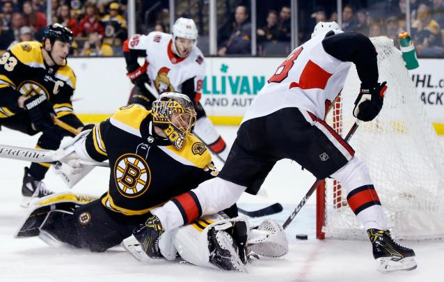 Ottawa Senators' Ryan Dzingel, right, scores on Boston Bruins' Anton Khudobin (35), of Kazakhstan, during the third period of an NHL hockey game in Boston, Saturday, April 7, 2018. The Bruins won 5-2. (AP Photo/Michael Dwyer)