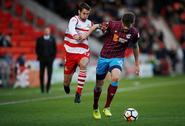 Soccer Football - FA Cup Second Round - Doncaster Rovers vs Scunthorpe United - Keepmoat Stadium, Doncaster, Britain - December 3, 2017 Doncaster Rovers' Matty Blair (L) in action with Scunthorpe United's Cameron Burgess Action Images/Craig Brough