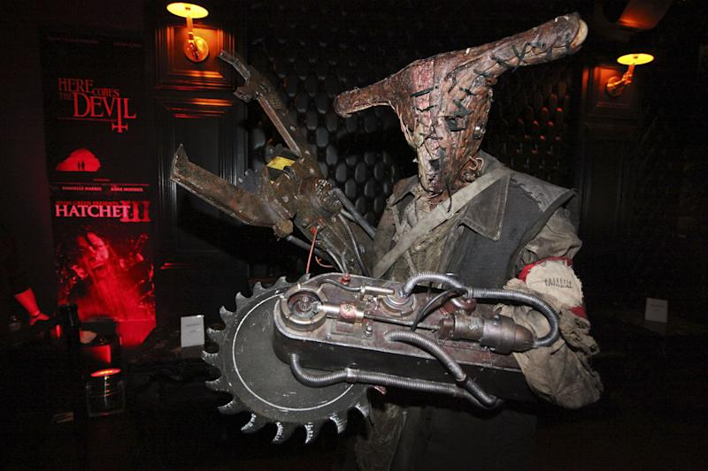 COMMERCIAL IMAGE -  Zombot character celebrates at the Fear Net and Resident Evil Party at Voyeur Nightclub for Comic-Con weekend on Friday July 13, 2012, in San Diego. (Photo by Jeff Bottari/Invision for MPI/Dark Sky Films/AP Images)