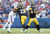 Pittsburgh Steelers quarterback Ben Roethlisberger (7) moves out of the reach of Buffalo Bills outside linebacker Matt Milano, left, with blocking by Najee Harris (22) during the second half of an NFL football game in Orchard Park, N.Y., Sunday, Sept. 12, 2021. (AP Photo/Joshua Bessex)