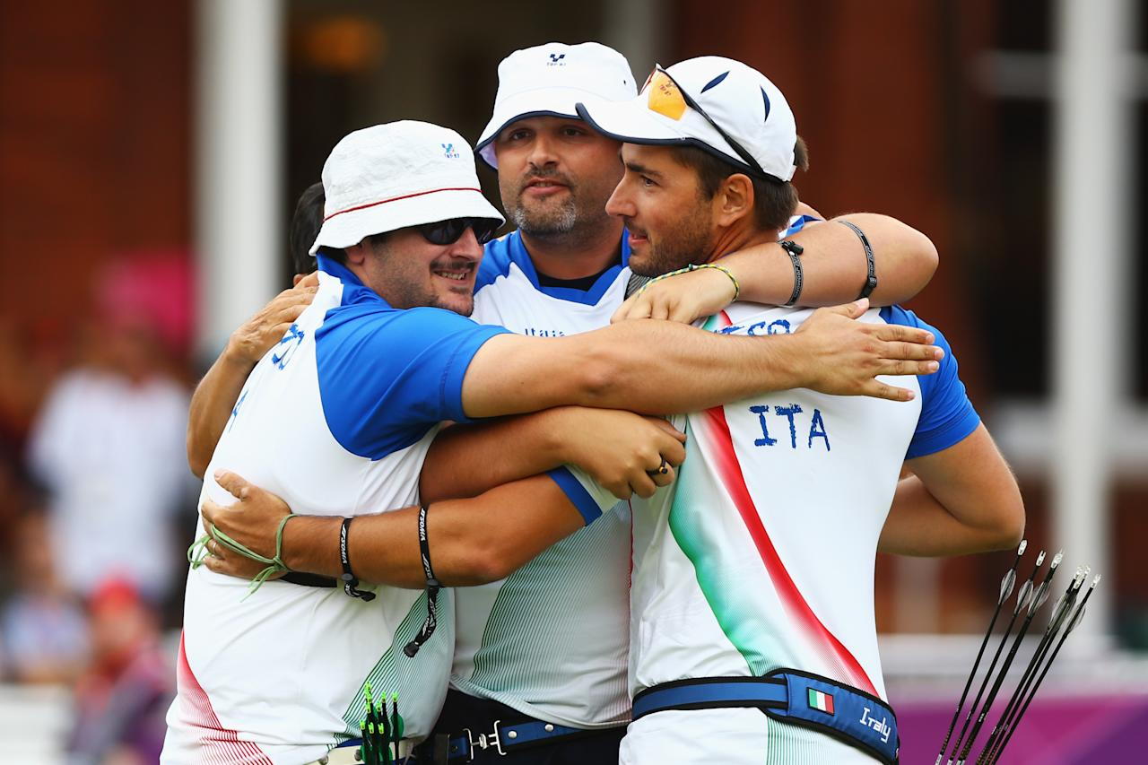 LONDON, ENGLAND - JULY 28:  (L-R) Marco Galiazzo, Michele Frangilli and Mauro Nespoli of Italy celebrate after victory in the Men's Team Archery semi final on Day 1 of the London 2012 Olympic Games at Lord's Cricket Ground on July 28, 2012 in London, England.  (Photo by Paul Gilham/Getty Images)