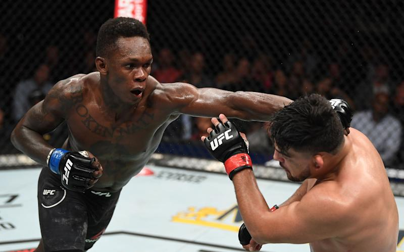 ATLANTA, GA - APRIL 13: (L-R) Israel Adesanya punches Kelvin Gastelum in their interim middleweight championship bout during the UFC 236 event at State Farm Arena on April 13, 2019 in Atlanta, Georgia. (Photo by Josh Hedges/Zuffa LLC/Zuffa LLC via Getty Images)