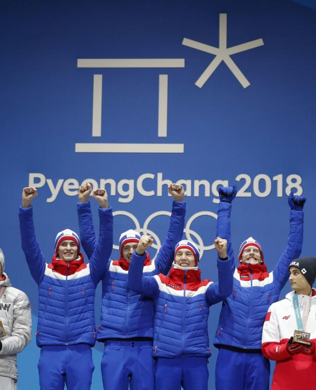 Medals Ceremony - Ski Jumping - Pyeongchang 2018 Winter Olympics - Men's Team - Medals Plaza - Pyeongchang, South Korea - February 20, 2018 - Gold medalists Daniel Andre Tande, Andreas Stjernen, Johann Andre Forfang and Robert Johansson of Norway on the podium. REUTERS/Kim Hong-Ji