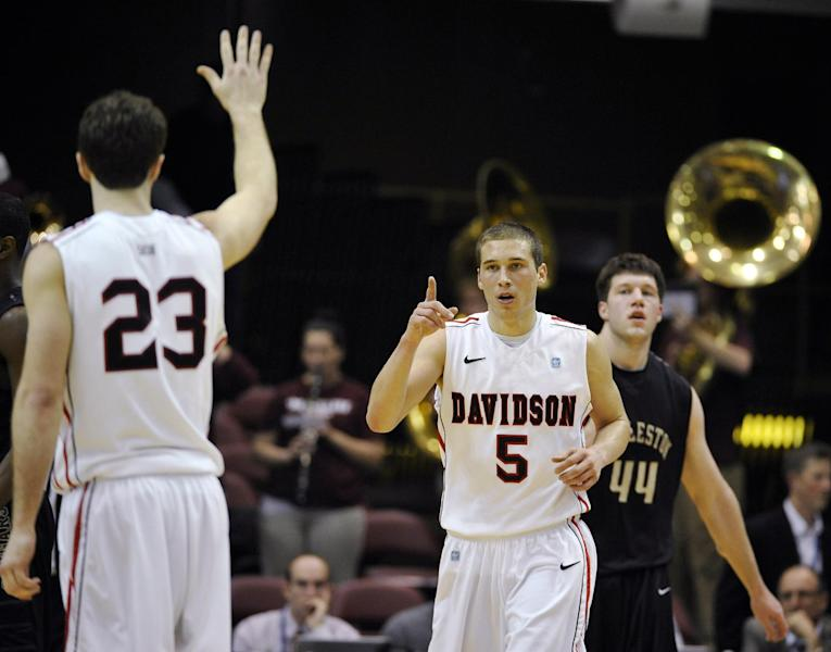 Davidson's JP Kuhlman (5) celebrates with Tom Droney (23) after scoring as College of Charleston's Trent Wiedeman (44) watches in the first half of an NCAA college basketball game during the Southern Conference tournament, Monday, March 11, 2013 in Asheville, N.C. (AP Photo/Rainier Ehrhardt)