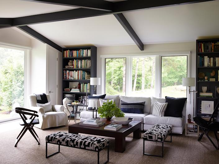 """<div class=""""caption""""> Smyth's office, which doubles as a guest room, features a seating area that includes his favorite vintage English armchair, a 1970s sofa upholstered in a <a href=""""https://www.fschumacher.com/"""" rel=""""nofollow noopener"""" target=""""_blank"""" data-ylk=""""slk:Schumacher"""" class=""""link rapid-noclick-resp"""">Schumacher</a> fabric, and benches from <a href=""""https://store.comerfordcollection.com/"""" rel=""""nofollow noopener"""" target=""""_blank"""" data-ylk=""""slk:Comerford Collection"""" class=""""link rapid-noclick-resp"""">Comerford Collection</a> covered in a <a href=""""https://www.cec-milano.com/"""" rel=""""nofollow noopener"""" target=""""_blank"""" data-ylk=""""slk:C&C Milano"""" class=""""link rapid-noclick-resp"""">C&C Milano</a> fabric. </div>"""