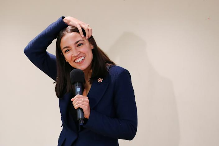 Rep. Alexandria Ocasio-Cortez, D-N.Y., smiles during a town hall in New York last week. (Lucas Jackson/Reuters)